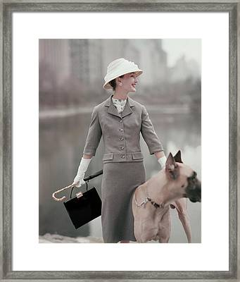 A Model Wearing A Gray Suit With A Dog Framed Print