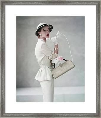 A Model Wearing A Handmacher Suit Framed Print