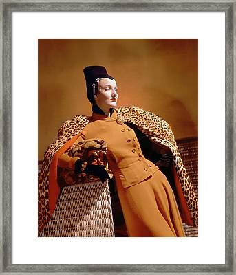 A Model Wearing A Leopard Print Cape And Orange Framed Print by Horst P. Horst