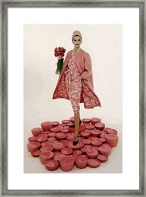 A Model Wearing A Matching Pink Outfit Holding Framed Print by William Bell