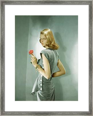 A Model Wearing A Matching Shirt And Skirt Framed Print