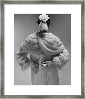 A Model Wearing A Mink Coat Framed Print