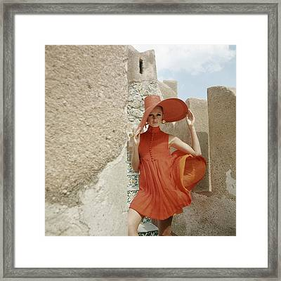 A Model Wearing A Orange Dress Framed Print