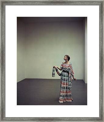 A Model Wearing A Patterned Dress Framed Print