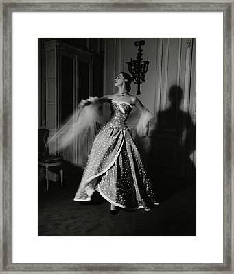 A Model Wearing A Polka Dot Dress Framed Print by John Rawlings