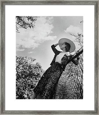 A Model Wearing A Polka Dot Suit Framed Print