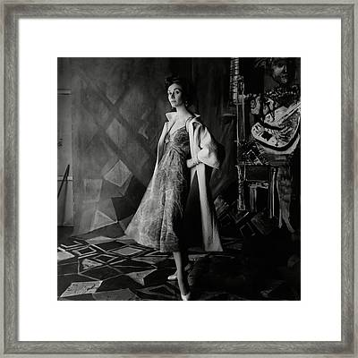 A Model Wearing A Printed Dress And Jacket Framed Print by Henry Clarke