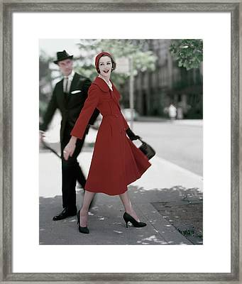 A Model Wearing A Red Coat Framed Print by Karen Radkai