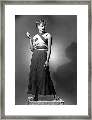 A Model Wearing A Ribbed Knit Dress Framed Print by Horst P. Horst