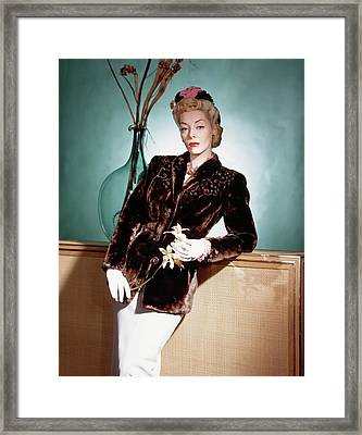 A Model Wearing A Sealskin Jacket Framed Print by Horst P. Horst