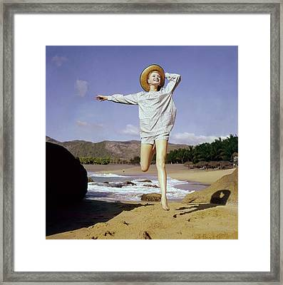 A Model Wearing A Smock Top And Matching Shorts Framed Print