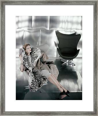 A Model Wearing A Snow Leopard Coat Framed Print by Henry Clarke