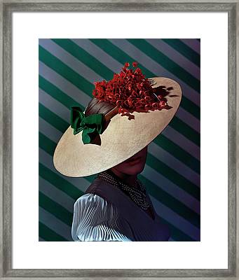 A Model Wearing A Straw Hat Framed Print by Andre Durst