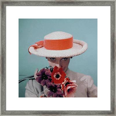 A Model Wearing A Straw Hat Framed Print by Clifford Coffin