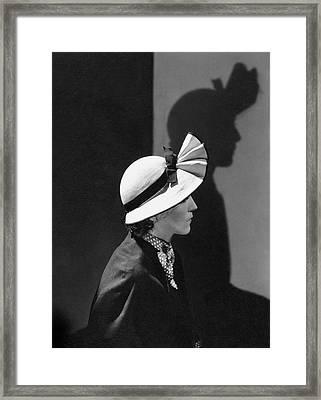 A Model Wearing A Straw Hat Framed Print by George Hoyningen-Huene