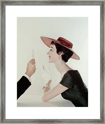 A Model Wearing A Sun Hat And Dress Framed Print