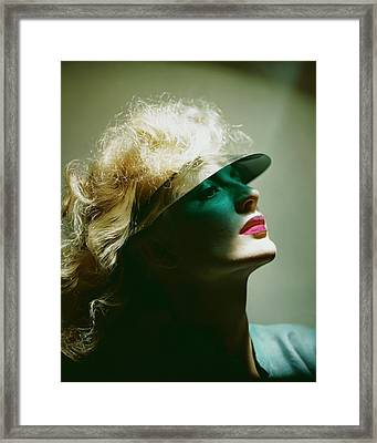 A Model Wearing A Sun Shade Framed Print by Erwin Blumenfeld
