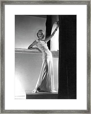 A Model Wearing A Sweater And Skirt Framed Print by Horst P. Horst