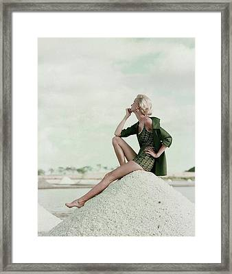 A Model Wearing A Swimsuit And Jacket Framed Print by Leombruno-Bodi