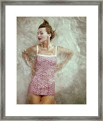A Model Wearing A Swimsuit Framed Print