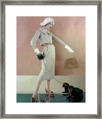 A Model Wearing A Tweed Jacket And Skirt Framed Print by Karen Radkai