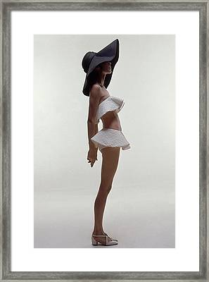 A Model Wearing A Two Piece Bathing Suit Framed Print by Bert Stern