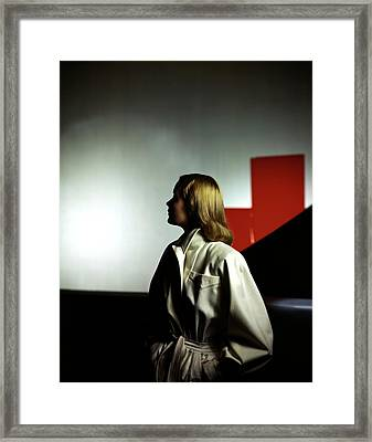A Model Wearing A White Coat Framed Print