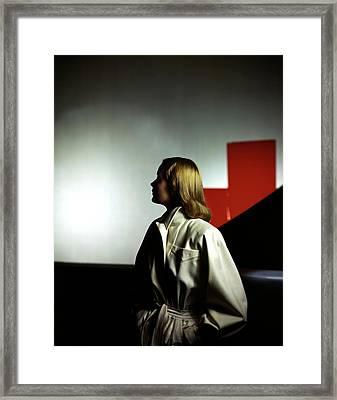 A Model Wearing A White Coat Framed Print