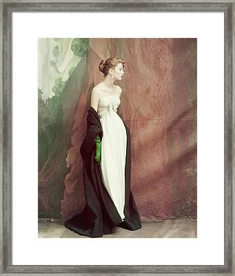 A Model Wearing A White Dress Framed Print by John Rawlings