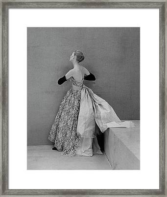 A Model Wearing An Evening Gown Framed Print by Henry Clarke