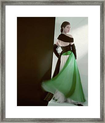 A Model Wearing An Evening Gown Framed Print