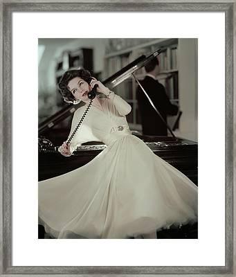 A Model Wearing An Evening Gown Leaning Framed Print by Karen Radkai