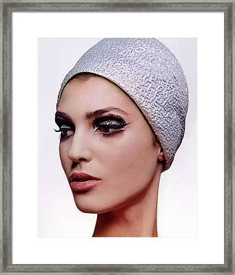 A Model Wearing Dark Eye Make-up Framed Print by Bert Stern