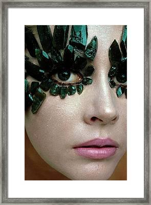 A Model Wearing Eye Ornaments Framed Print by Gianni Penati