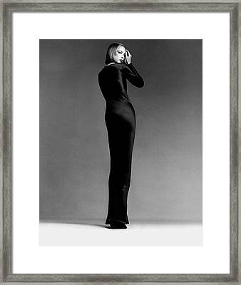 A Model Wearing Halston Framed Print by Francesco Scavullo