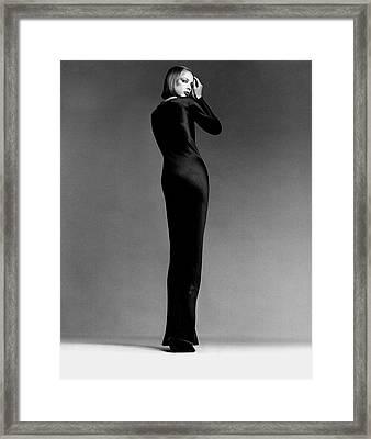 A Model Wearing Halston Framed Print
