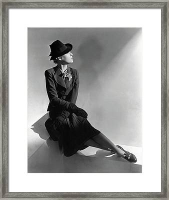 A Model Wearing Molyneux And A Hat By Descat Framed Print