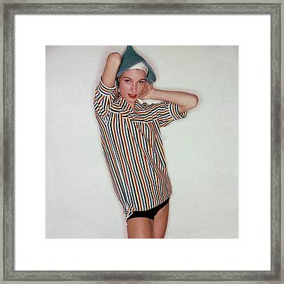 A Model Wearing Swimwear And A Striped Shirt Framed Print by Clifford Coffin