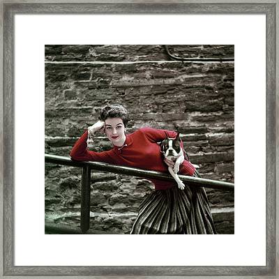 A Model With A Dog Leaning On A Railing Framed Print