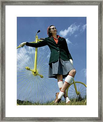 A Model With An Old-fashioned Bicycle Framed Print by Toni Frissell