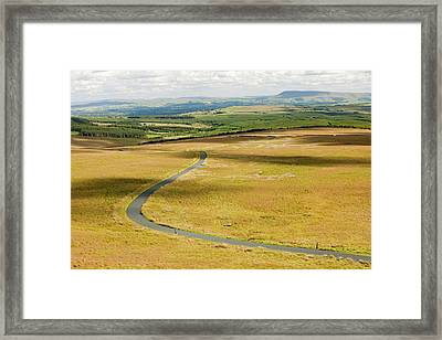 A Moorland Road Framed Print by Ashley Cooper