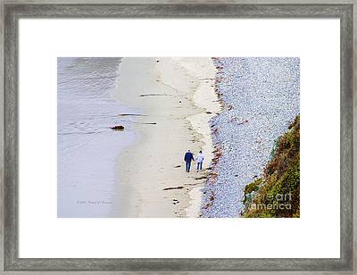 A Morning Walk Along The Beach  Framed Print
