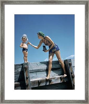 A Mother And Son On A Pier Framed Print by Toni Frissell