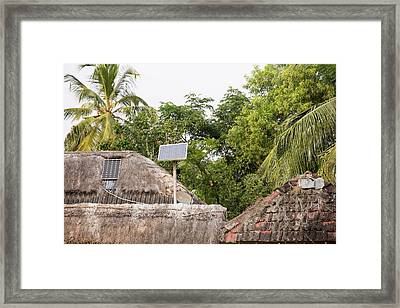 A Mud Hut With A Small Solar Panel Framed Print by Ashley Cooper