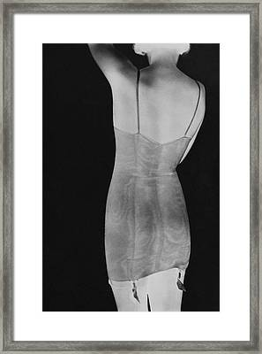 A Negative Print Of A Woman Wearing A Corset Framed Print