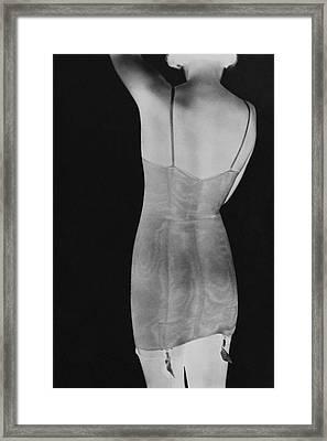 A Negative Print Of A Woman Wearing A Corset Framed Print