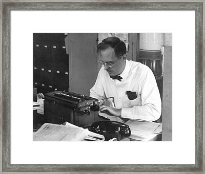 A Newspaper Re-write Man Framed Print by Underwood Archives