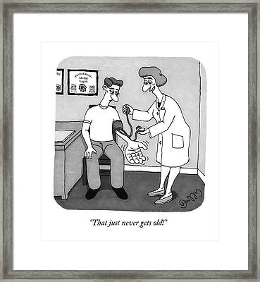 A Nurse Takes A Patient's Blood Pressure Framed Print