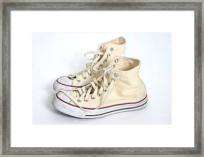 A Pair Of Cream Hightop Sneakers Framed Print by Daniel Sicolo