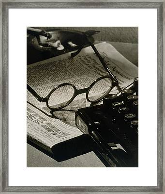 A Pair Of Glasses On Top Of A Newspaper Framed Print by Irving Browning